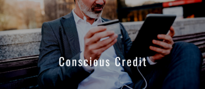 Conscious Credit text on image of man on bench with headphones in, tablet in one hand and credit card in the other