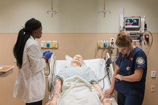 Nursing students working on mannequin