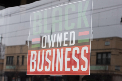 Black Owned Business sign in window