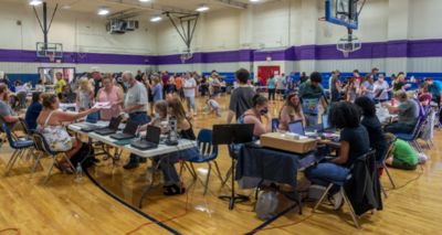 families at school registration tables