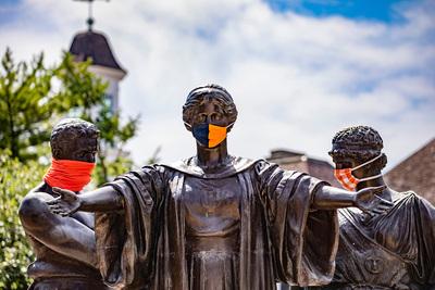 Masked Alma Mater statue