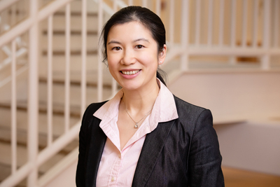 Asian female in suit by staircase