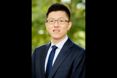Asian male in suit with glasses